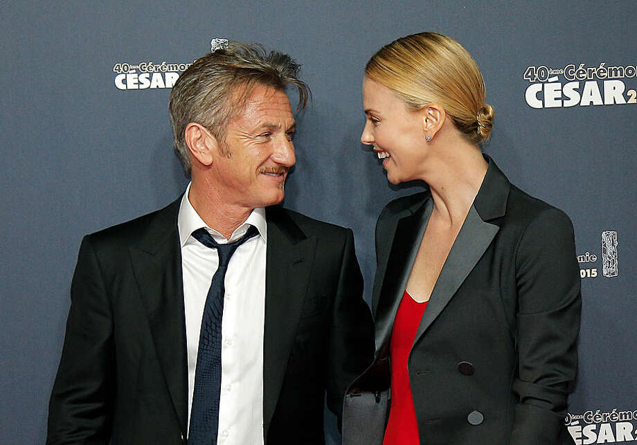 Sean Penn and Charlize Theron arrives at the 40th French Cesar Awards Ceremony, in Paris, Friday Feb. 20, 2015. This annual ceremony is presented by the French Academy of Cinema Arts and Techniques. (AP Photo/Thibault Camus)