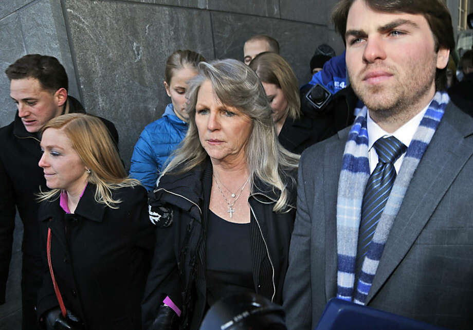 Former first lady Maureen McDonnell, center, leaves federal court with her son Bobby, right, and daughter Cailin Young, left, after being sentenced to one year and one day on corruption charges in Richmond, Va., Friday, Feb. 20, 2015. Fighting back tears, McDonnell apologized to her family and Virginians and said she takes full responsibility. (AP Photo/Steve Helber)