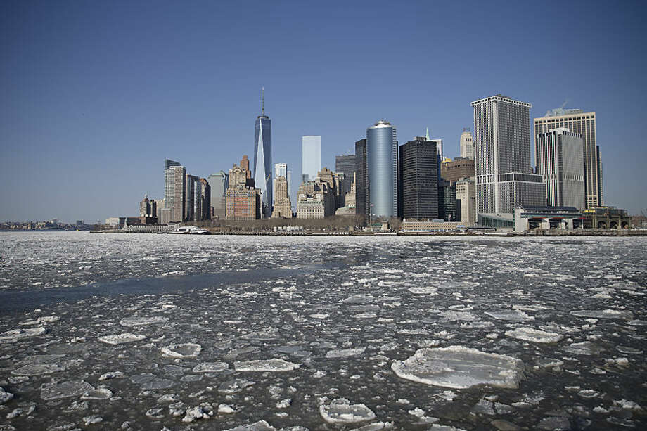 Ice flows pass through New York Harbor, Friday, Feb. 20, 2015, in New York. Arctic air and bitterly cold wind is moving across the Northeast, plunging temperatures into record low single digits, accompanied by subzero wind chills. (AP Photo/John Minchillo)