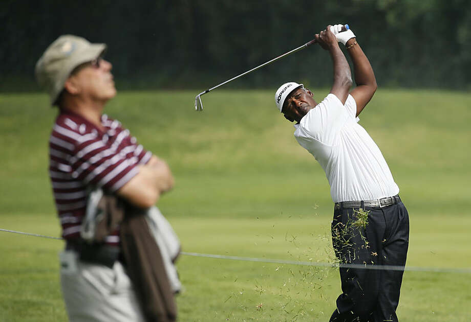 Vijay Singh of Fiji hits from the 12th fairway as a spectator watches the ball during the second round of the Northern Trust Open golf tournament at Riviera Country Club in the Pacific Palisades area of Los Angeles on Friday, Feb. 20, 2015. (AP Photo/Danny Moloshok)