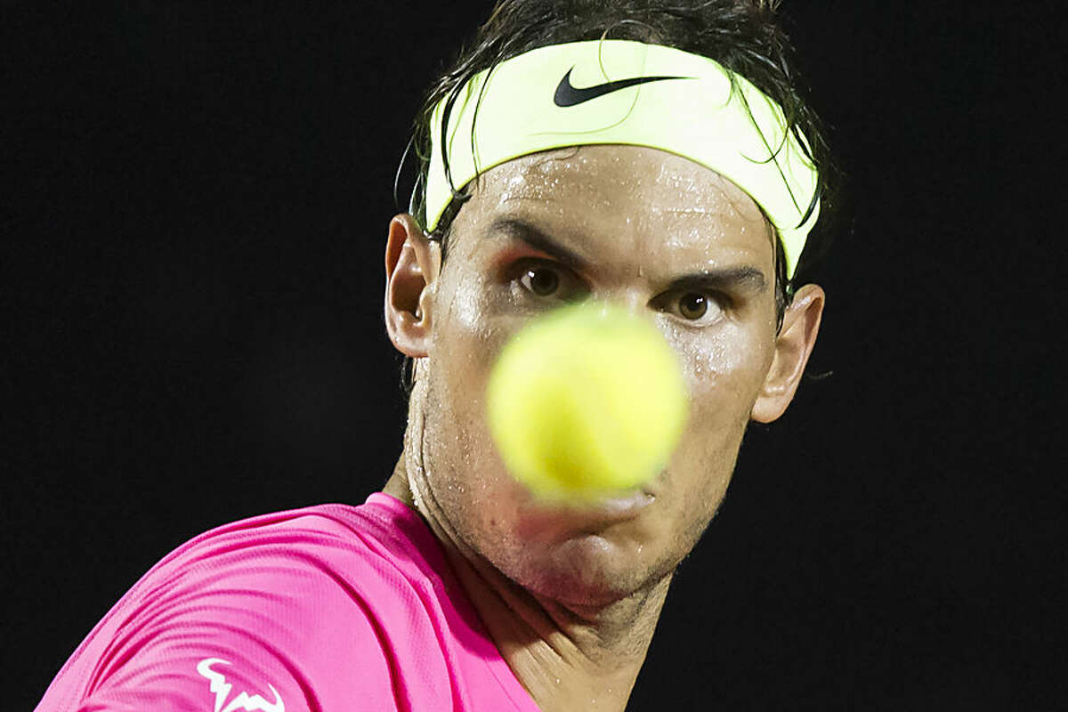 Rafael Nadal, of Spain, eyes a ball at the quarter-finals match of the Rio Open tennis tournament against Pablo Cuevas of Uruguay in Rio de Janeiro, Brazil, early Saturday, Feb. 21, 2015. (AP Photo/Felipe Dana)