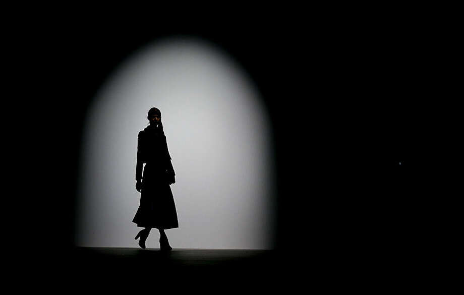 A model wears an outfit by designer Bora Aksu during the Autumn/Winter 2015 show at London Fashion Week in London, Friday, Feb. 20, 2015. (AP Photo/Kirsty Wigglesworth)