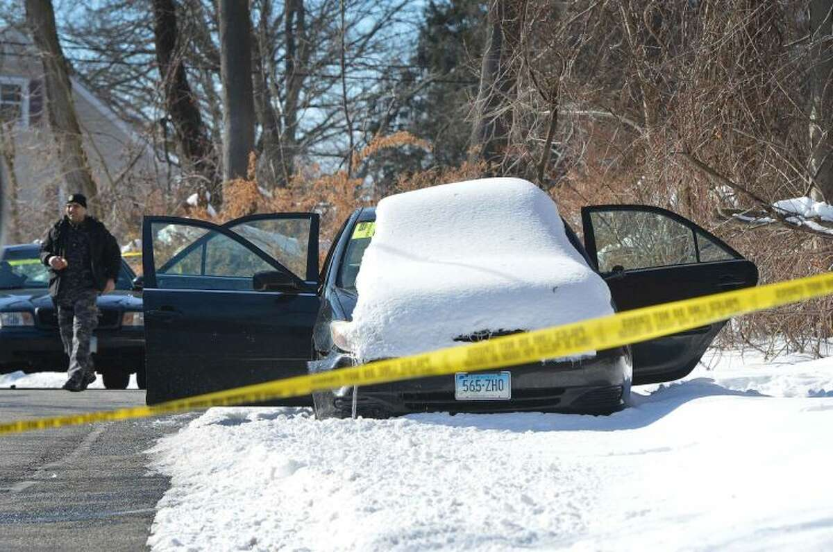 Hour Photo/Alex von Kleydorff Police investigate a deceased male that was found in the back seat of this abandoned Toyota on Grey Rock Road in Norwalk on Tuesday morning.