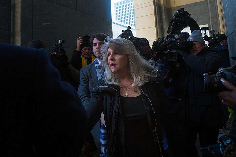 Former Virginia first lady Maureen McDonnell arrives at federal court with her son Bobby, left, for her sentencing in Richmond, Va., Friday, Feb. 20, 2015. Federal prosecutors have recommended an 18-month prison term, six months less than former Gov. Bob McDonnell received when he was convicted on 11 counts last month. (AP Photo/The Virginian-Pilot, Hyunsoo Leo Kim) MAGS OUT