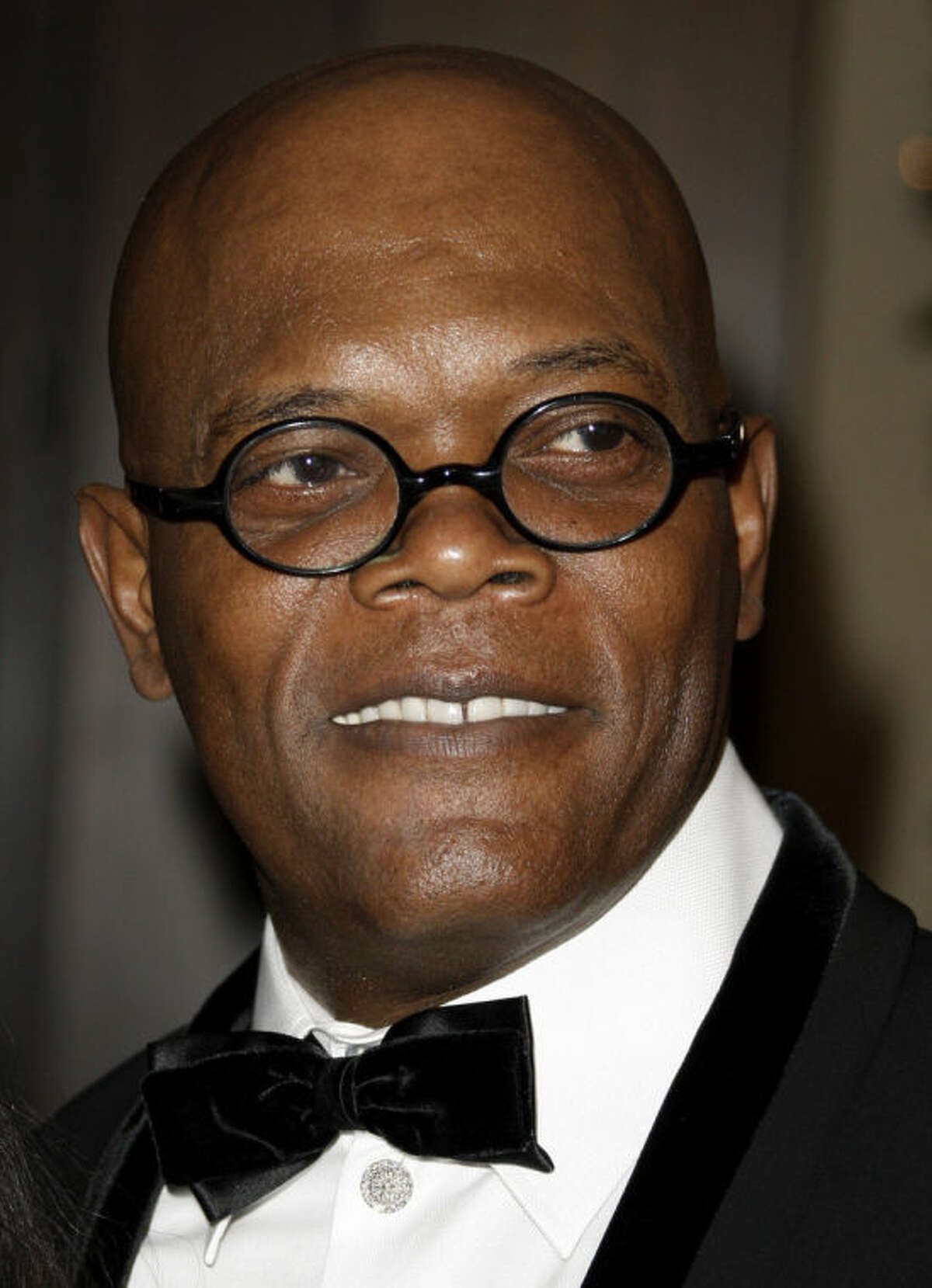 File-This Dec. 1, 2008 file photo shows actor Samuel L. Jackson arriving at the American Cinematheque Award gala honoring him in Beverly Hills, Calif. Los Angeles newscaster has apologized to Jackson for confusing him with Laurence Fishburne. KTLA entertainment reporter Sam Rubin was interviewing Jackson on Monday Feb. 10, 2014, about the forthcoming film