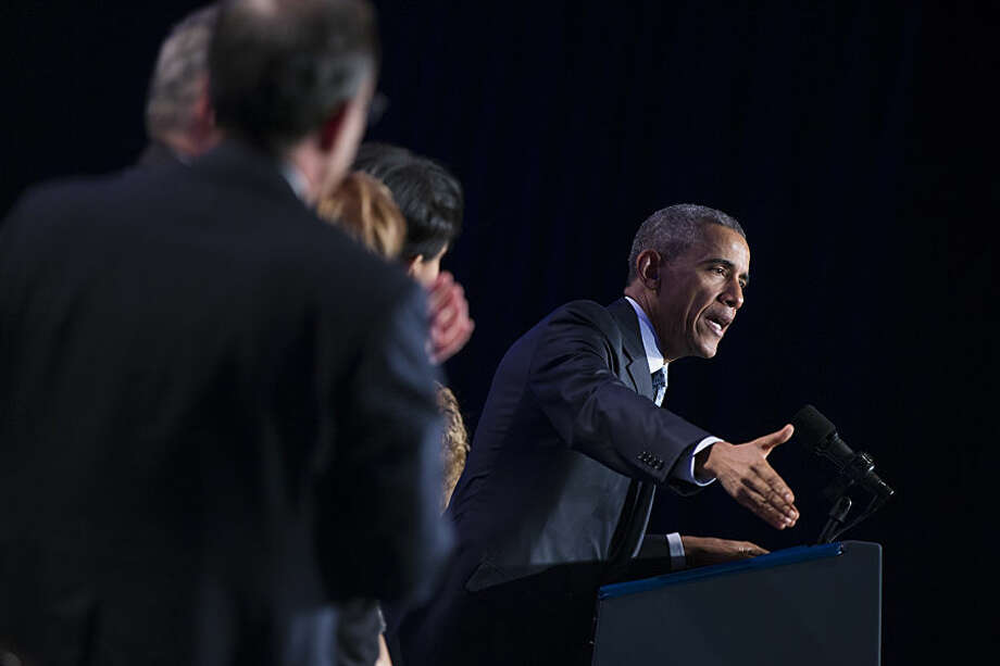 "President Barack Obama speaks at the Democratic National Committee winter meeting in Washington, Friday, Feb. 20, 2015. Taunting Republicans, the president said it's ""not an accident"" that the economy is improving on his watch and that Republicans' ""doom and gloom"" predictions haven't come true. (AP Photo/Evan Vucci)"