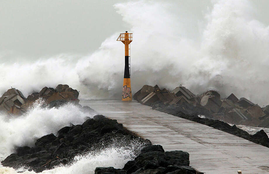 Huge waves his the sea defences at the beach in Anglet, southwestern France, Friday, Feb. 20, 2015. There is a weather alert for high waves in the south west of France for the coming weekend, whipped up by storm winds and high spring tides. (AP Photo/Bob Edme)