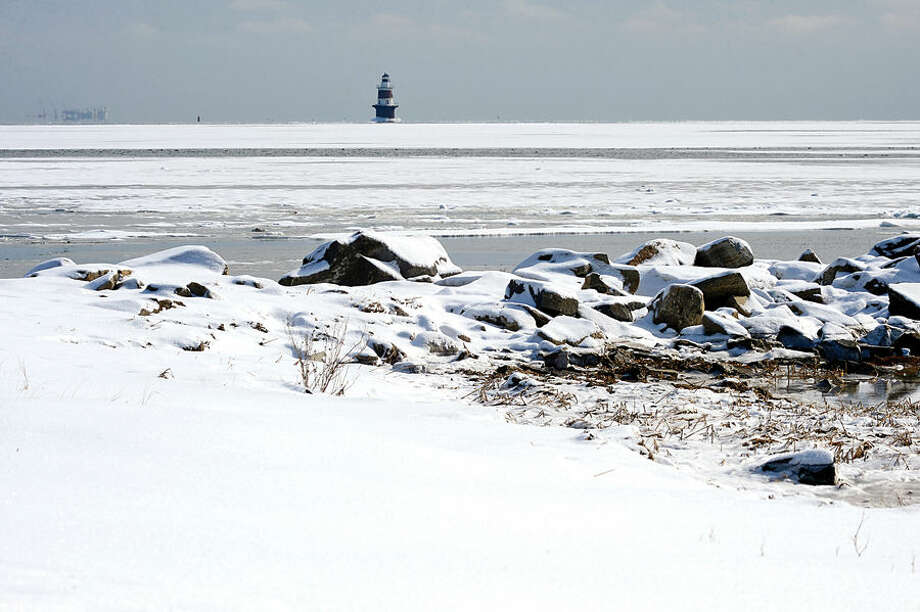 Hour photo / Erik Trautmann Long Island Sound appears frozen over as temperatures dipped near zeron this week.