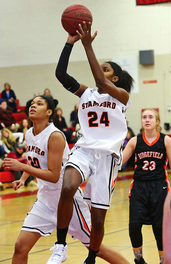 Hour photo / Erik Trautmann Stamford High School battles Ridgefield during the FCIAC Girls Basketball Quarterfinals Saturday at Fairfield Warde High School.