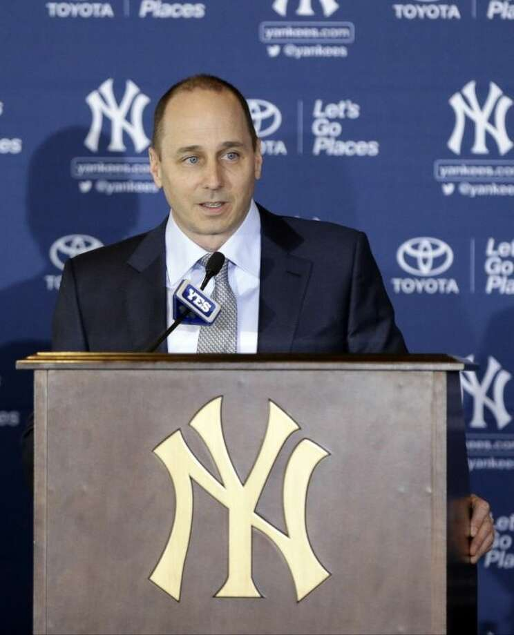 New York Yankees general manager Brian Cashman speaks during a news conference, where Masahiro Tanaka of Japan was introduced as a new pitcher for the team, at Yankee Stadium Tuesday, Feb. 11, 2014, in New York. (AP Photo/Frank Franklin II)