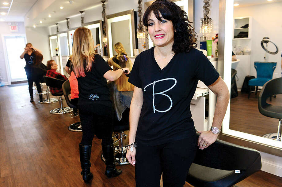 Hour photo / Erik Trautmann Donna Capomolla, owner of Bella Salon on High Ridge Road in Stamford has opened a new salon in the same space where she owned Double Take Salon in the 90's but sold it after giving birth to her first child.