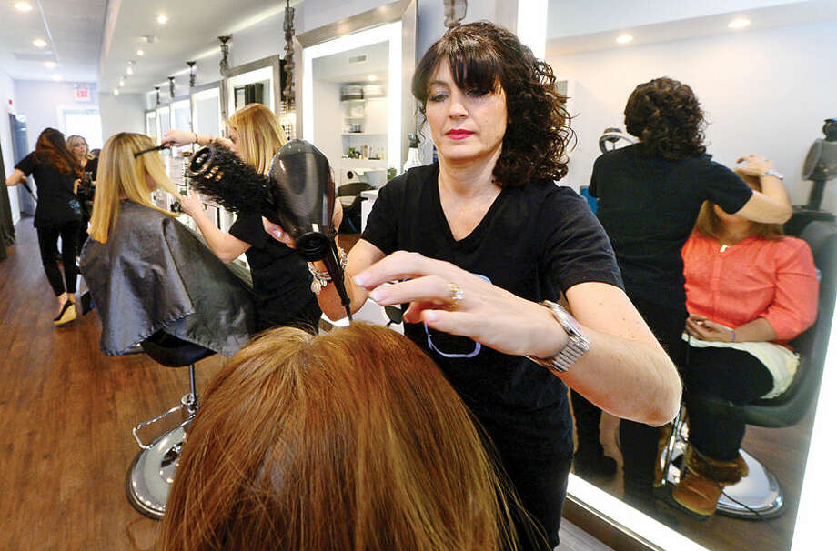 Hour photo / Erik Trautmann Donna Capomolla, owner of Bella Salon on High Ridge Road in Stamford, has opened a new salon in the same space where she owned Double Take Salon in the 90's but sold it after giving birth to a child.