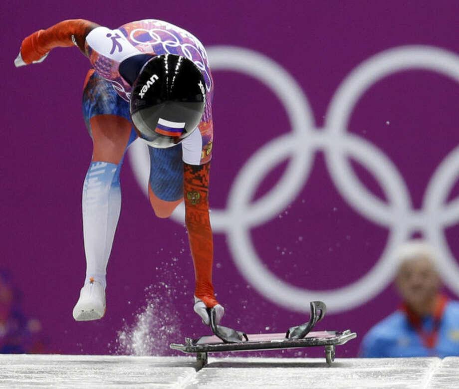 Elena Nikitina of Russia starts her third run during the women's skeleton competition at the 2014 Winter Olympics, Friday, Feb. 14, 2014, in Krasnaya Polyana, Russia. (AP Photo/Natacha Pisarenko)
