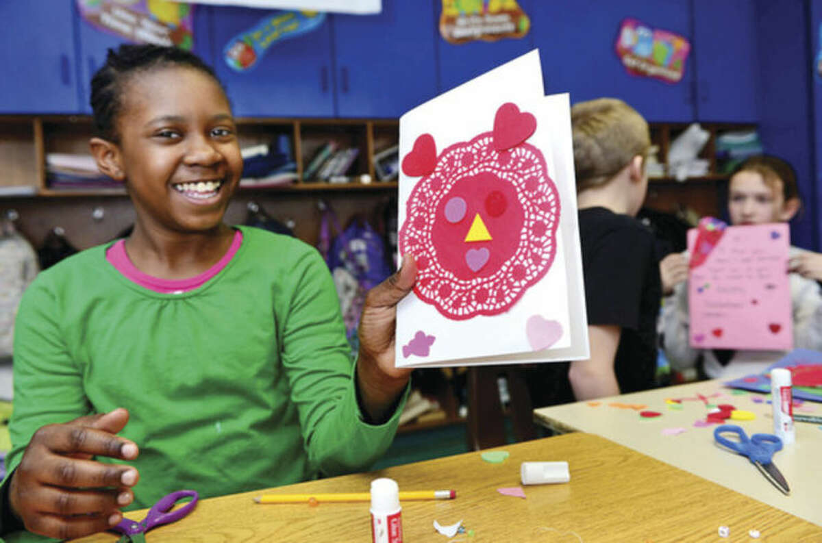 Hour photo / Erik Trautmann Rowayton Elementary School 4th graders is Maura Fried's class make valentines Tuesday for veterans at the VA Hospital in West Haven.