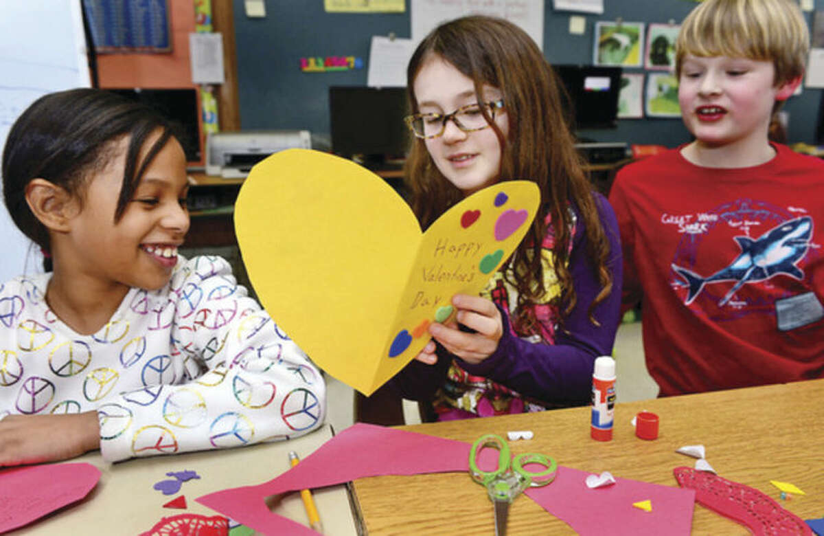 Hour photo / Erik Trautmann Rowayton Elementary School fourth-graders in Maura Fried's class make valentines Tuesday for veterans at the VA Hospital in West Haven.