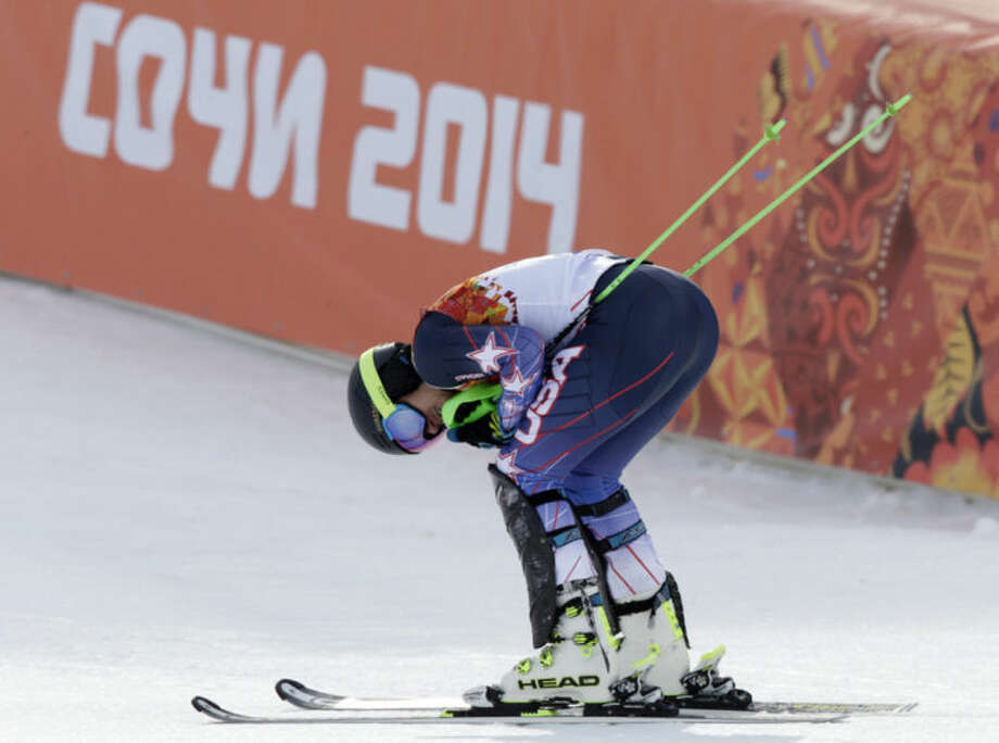 United States' Ted Ligety rests after finishing the slalom portion of the men's supercombined at the Sochi 2014 Winter Olympics, Friday, Feb. 14, 2014, in Krasnaya Polyana, Russia. (AP Photo/Gero Breloer)