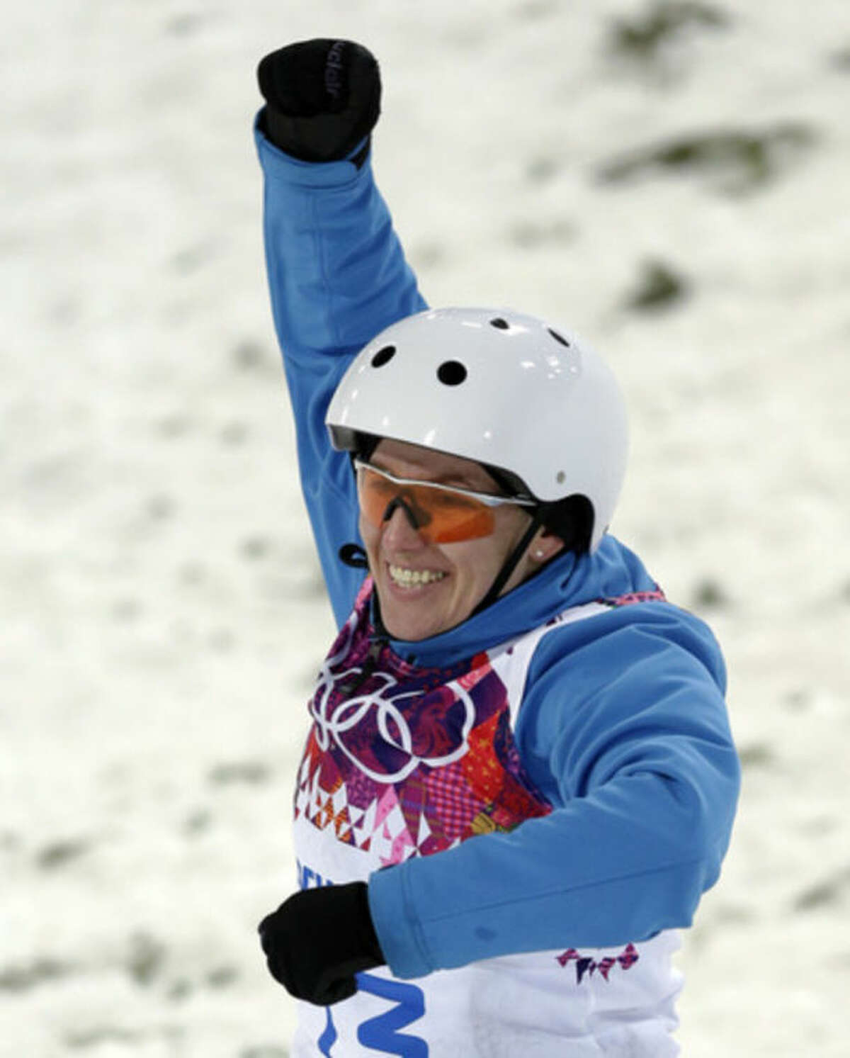 Alla Tsuper of Belarus celebrates after landing her final jump in the women's freestyle skiing aerials final at the Rosa Khutor Extreme Park, at the 2014 Winter Olympics, Friday, Feb. 14, 2014, in Krasnaya Polyana, Russia. Tsuper won the gold medal. (AP Photo/Andy Wong)