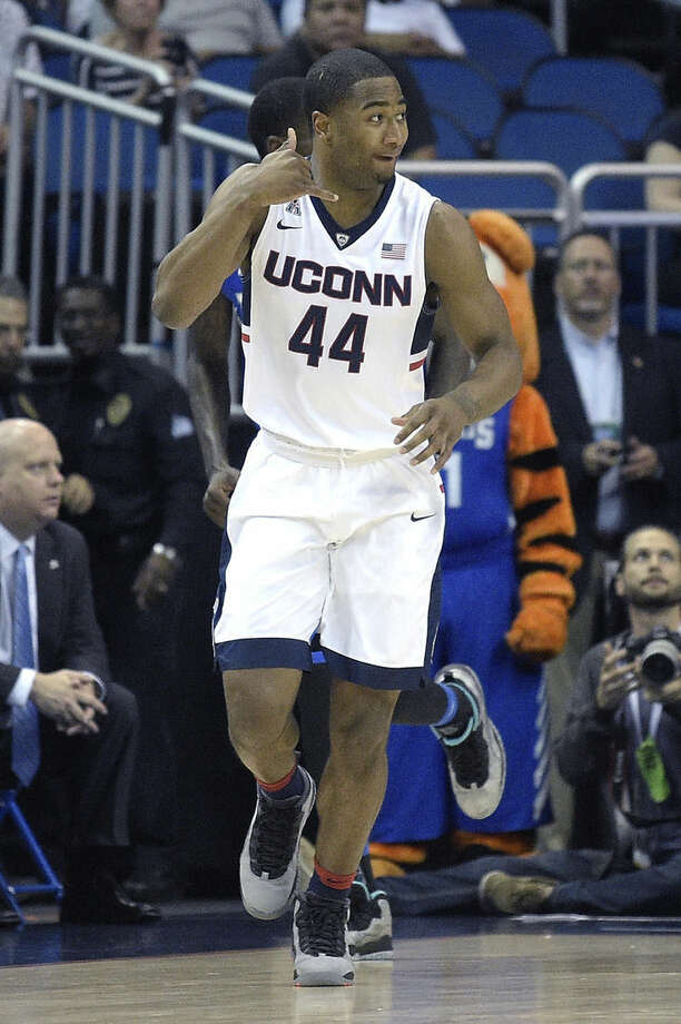 Connecticut guard Rodney Purvis (44) celebrates after scoring a three-pointer during the first half of an NCAA college basketball game against Memphis in the finals of the American Athletic Conference men's tournament in Orlando, Fla., Sunday, March 13, 2016. (AP Photo/Phelan M. Ebenhack)