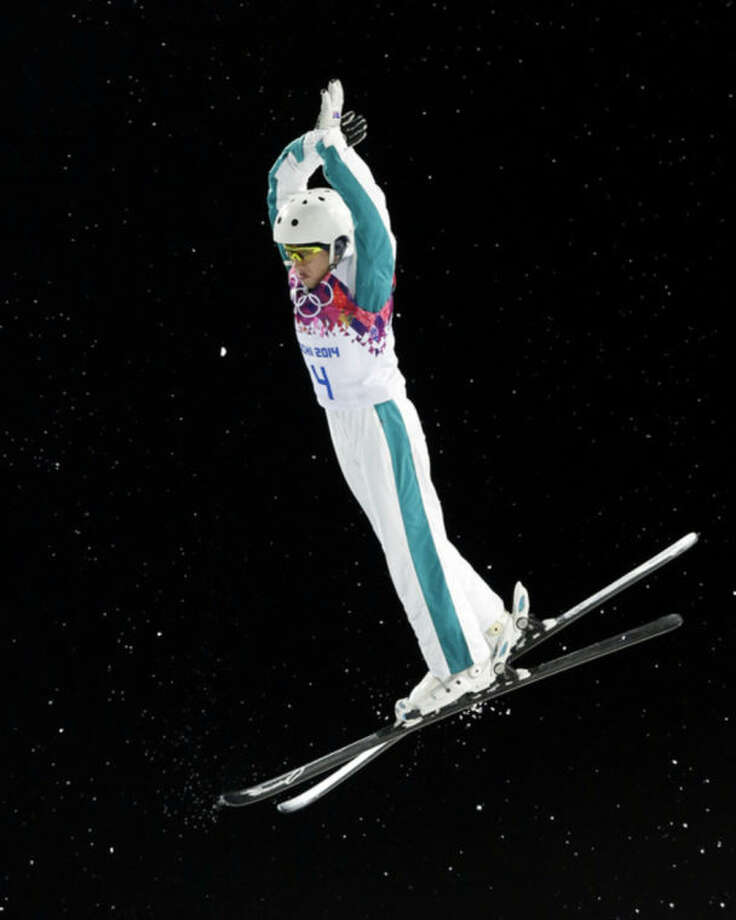 Australia's Lydia Lassila makes her final jump in the women's freestyle skiing aerials final at the Rosa Khutor Extreme Park, at the 2014 Winter Olympics, Friday, Feb. 14, 2014, in Krasnaya Polyana, Russia. (AP Photo/Andy Wong)