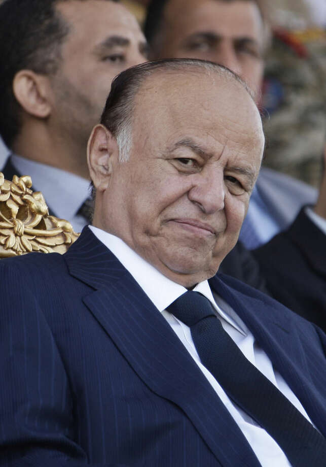 FILE - In this May 22, 2012 file photo, then Yemeni President Abed Rabbu Mansour Hadi attends a ceremony to commemorate the 22nd anniversary of Yemen's reunification, in Sanaa, Yemen. Hadi, Yemen's former president left the capital after Shiite rebels who surrounded his house let him go under international and local pressure, aides close to him said Saturday, Feb. 21, 2015. Hadi has been under house arrest for several weeks following a coup by Shiite Houthi rebels. Hadi arrived in Aden and later plans to leave the country to receive medical treatment, aides said. (AP Photo/Hani Mohammed, File)