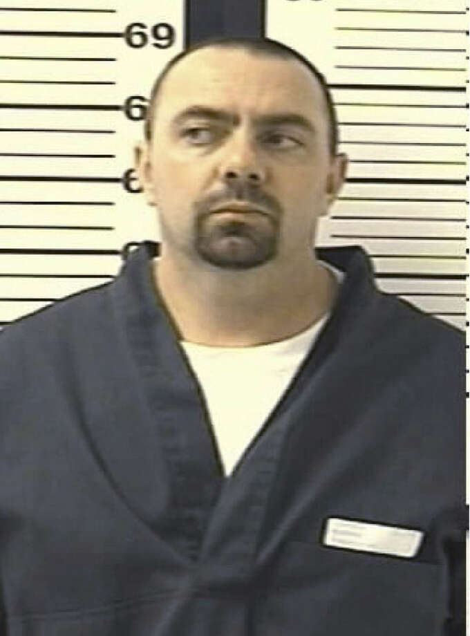 This is a Sept. 1, 2009, booking photograph owned by the Colorado Department of Corrections and taken in Denver of Thaddeus Murphy of Colorado Springs, Colo. Murphy has been arrested in connection with the explosion at a building in Colorado Springs on Jan. 6, 2015, that houses a barber shop and local chapter of the NAACP. (AP Photo/Colordo Department of Corrections, HO)