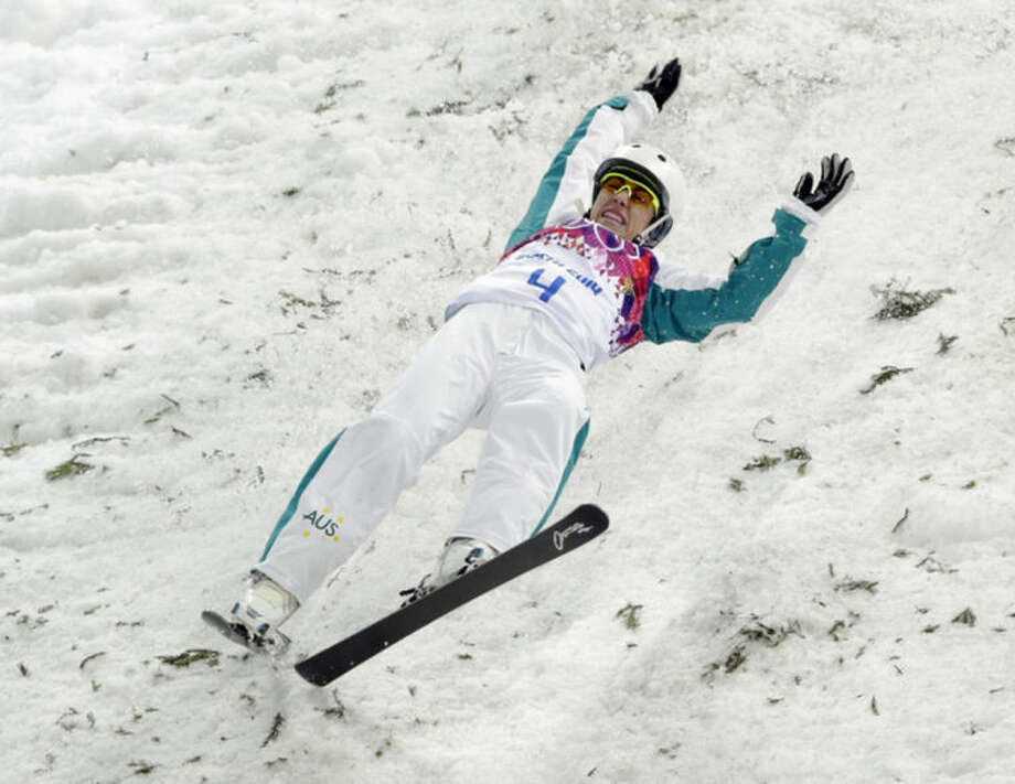 Australia's Lydia Lassila crashes on her final jump in the women's freestyle skiing aerials final at the Rosa Khutor Extreme Park, at the 2014 Winter Olympics, Friday, Feb. 14, 2014, in Krasnaya Polyana, Russia. (AP Photo/Andy Wong)