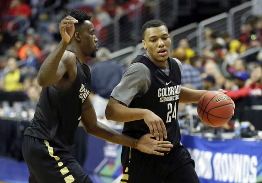 Colorado guard George King, right, drives past teammate Wesley Gordon during practice for a first-round men's college basketball game in the NCAA Tournament, Wednesday, March 16, 2016, in Des Moines, Iowa. Colorado will play Connecticut on Thursday. (AP Photo/Charlie Neibergall)