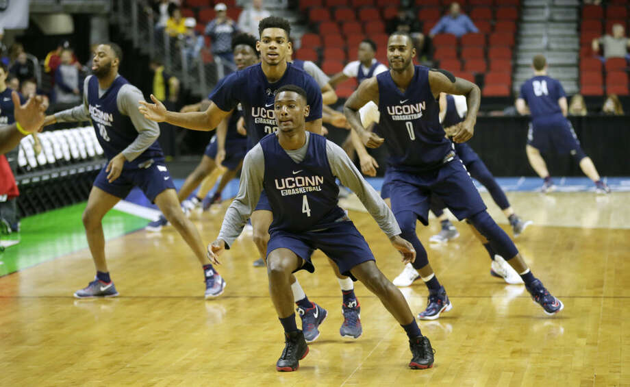 Connecticut guard Sterling Gibbs runs with teammates during practice for a first-round men's college basketball game in the NCAA Tournament, Wednesday, March 16, 2016, in Des Moines, Iowa. Connecticut will play Colorado on Thursday. (AP Photo/Charlie Neibergall)