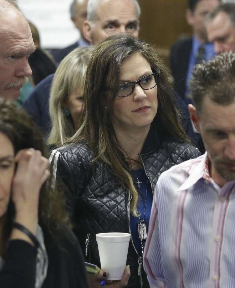 Taya Kyle, wife of former Navy SEAL Chris Kyle, leaves the courtroom after a break in the capital murder trial of Eddie Ray Routh at the Erath County, Donald R. Jones Justice Center Friday, Feb. 20, 2015, in Stephenville, Texas. Routh, 27, of Lancaster, is charged with the 2013 deaths of Kyle and his friend Chad Littlefield at a shooting range near Glen Rose, Texas. (AP Photo/LM Otero,Pool)
