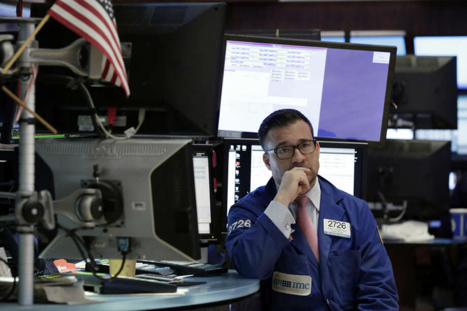 Specialist Paul Cosentino waits for trading to begin on the floor of the New York Stock Exchange, Tuesday, March 15, 2016. U.S. stocks tumbled in the first minutes of trading as falling commodity prices again pulled energy and materials companies lower. (AP Photo/Richard Drew)