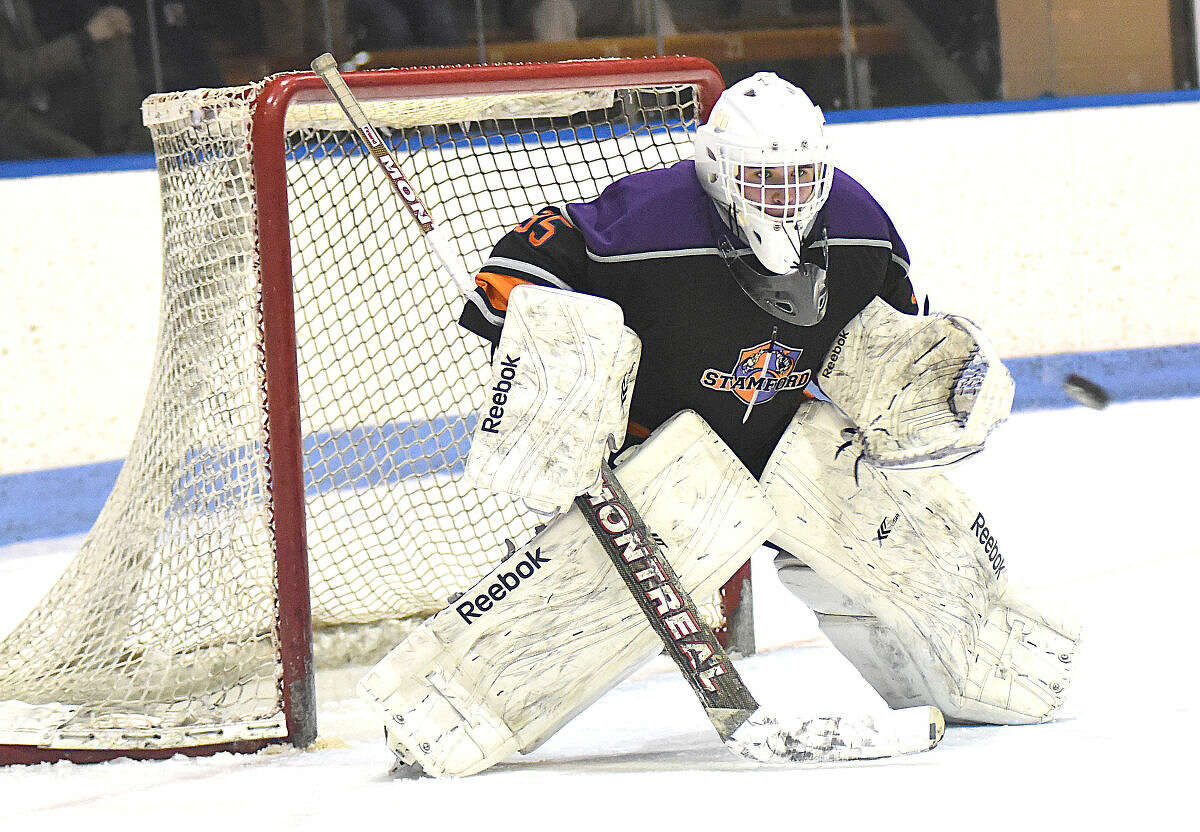 Christian Compolattaro of Westhill-Stamford keeps his eye on the puck during Tuesday's CIAC Division 3 semifinal against New Fairfield-Immaculate at Yale University's Ingalls Rink.