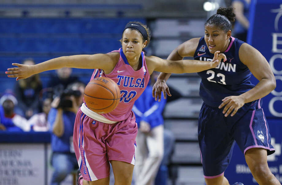 Tulsa guard Kelsee Grovey (00) and Connecticut forward Kaleena Mosqueda-Lewis (23) chase a loose ball in the first half of an NCAA college basketball game in Tulsa, Okla., Saturday, Feb. 21, 2015. (AP Photo/Sue Ogrocki)