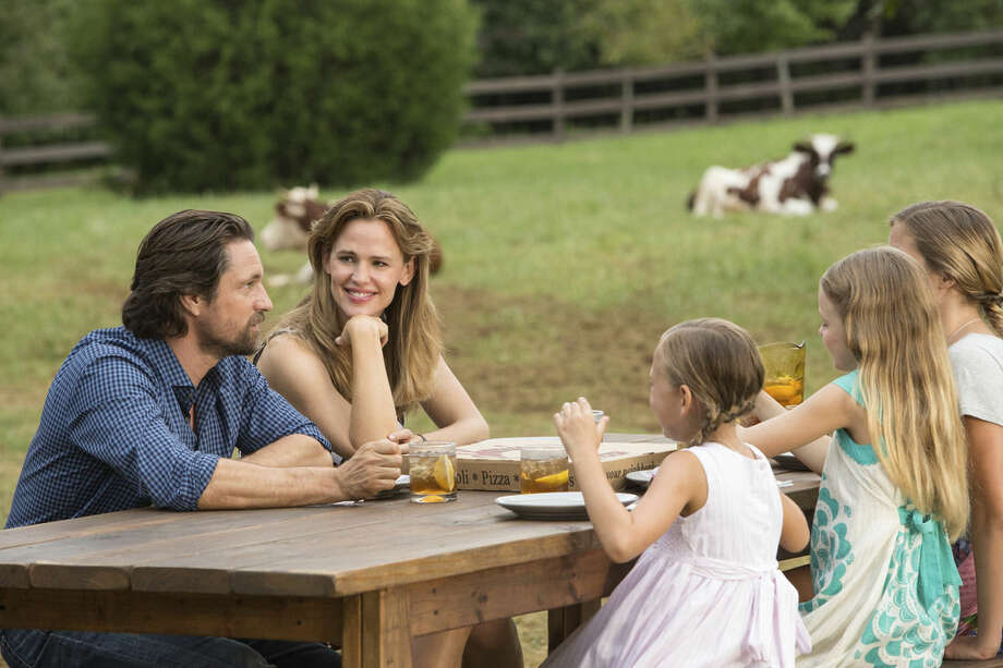 "This image released by Sony Pictures shows, from left, Martin Henderson, Jennifer Garner, Brighton Sharbino, Kylie Rogers and Courtney Fansler in a scene from Columbia Pictures', ""Miracles from Heaven."" (Chuck Zlotnick/Sony Pictures via AP)"