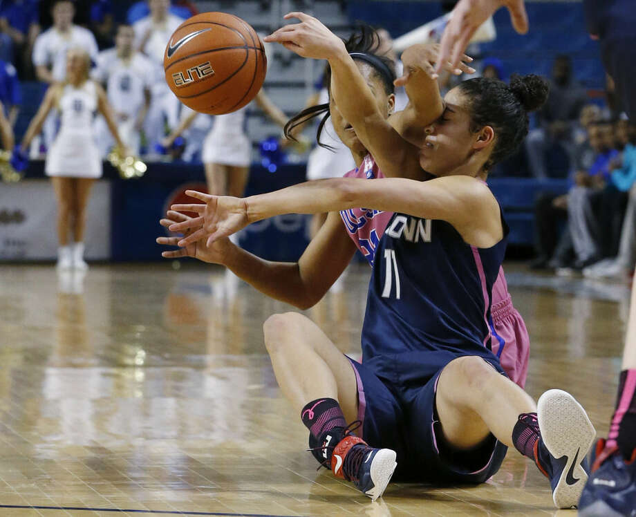 Connecticut guard Kia Nurse (11) is fouled by Tulsa guard Ashley Clark, left, as they reach for the ball in the second half of an NCAA college basketball game in Tulsa, Okla., Saturday, Feb. 21, 2015. Connecticut won 92-46. (AP Photo/Sue Ogrocki)
