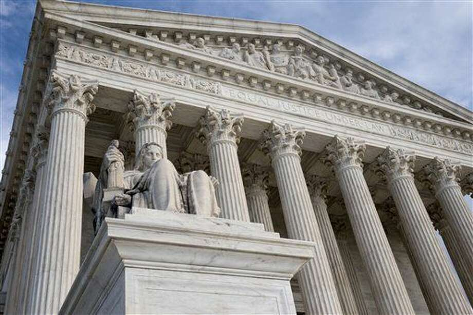 FILE - This Feb. 17, 2016 file photo shows the Supreme Court in Washington. President Barack Obama said Wednesday he will reveal his Supreme Court nominee to fill the vacancy of the late Justice Antonin Scalia, and his pick is expected to come from a small circle of federal appeals court judges. (AP Photo/J. Scott Applewhite)