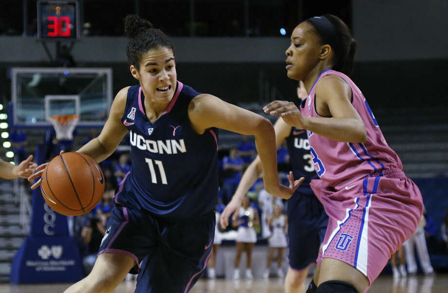 Connecticut guard Kia Nurse (11) drives around Tulsa guard Ashley Clark in the first half of an NCAA college basketball game in Tulsa, Okla., Saturday, Feb. 21, 2015. Connecticut won 92-46. (AP Photo/Sue Ogrocki)