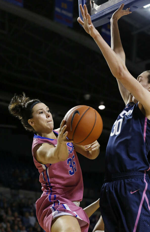 Tulsa guard Kadan Brady (35) attempts to pass around Connecticut forward Breanna Stewart, right, in the second half of an NCAA college basketball game in Tulsa, Okla., Saturday, Feb. 21, 2015. Connecticut won 92-46. (AP Photo/Sue Ogrocki)