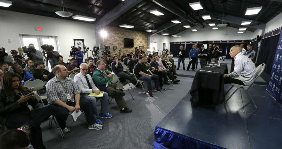 New York Yankees manager Joe Girardi, right, speaks during a news conference following a spring training baseball practice Friday, Feb. 14, 2014, in Tampa, Fla. (AP Photo/Charlie Neibergall)