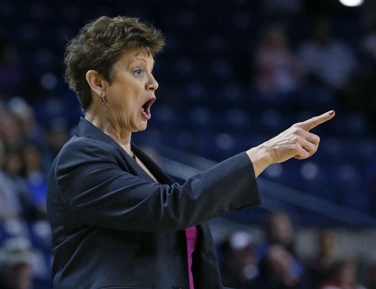 Tulsa head coach Matilda Mossman gives instructions to players in the first half of an NCAA college basketball game against Connecticut in Tulsa, Okla., Saturday, Feb. 21, 2015. Connecticut won 92-46. (AP Photo/Sue Ogrocki)
