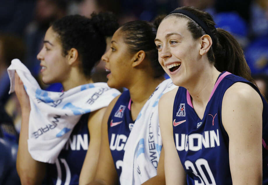 Connecticut forward Breanna Stewart smiles on the bench in the second half of an NCAA college basketball game against Tulsa in Tulsa, Okla., Saturday, Feb. 21, 2015. Connecticut won 92-46. (AP Photo/Sue Ogrocki)