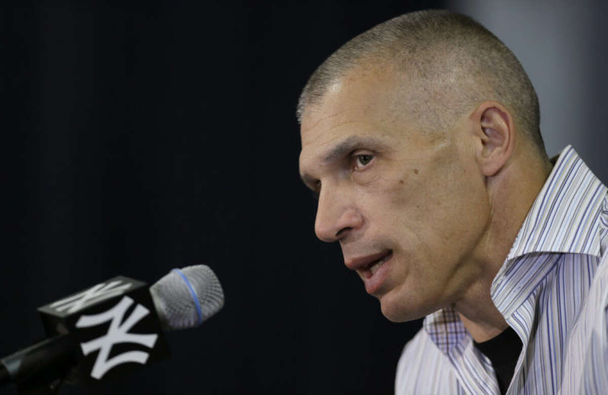 New York Yankees manager Joe Girardi speaks during a news conference following a practice at baseball spring training, Friday, Feb. 14, 2014, in Tampa, Fla. (AP Photo/Charlie Neibergall)