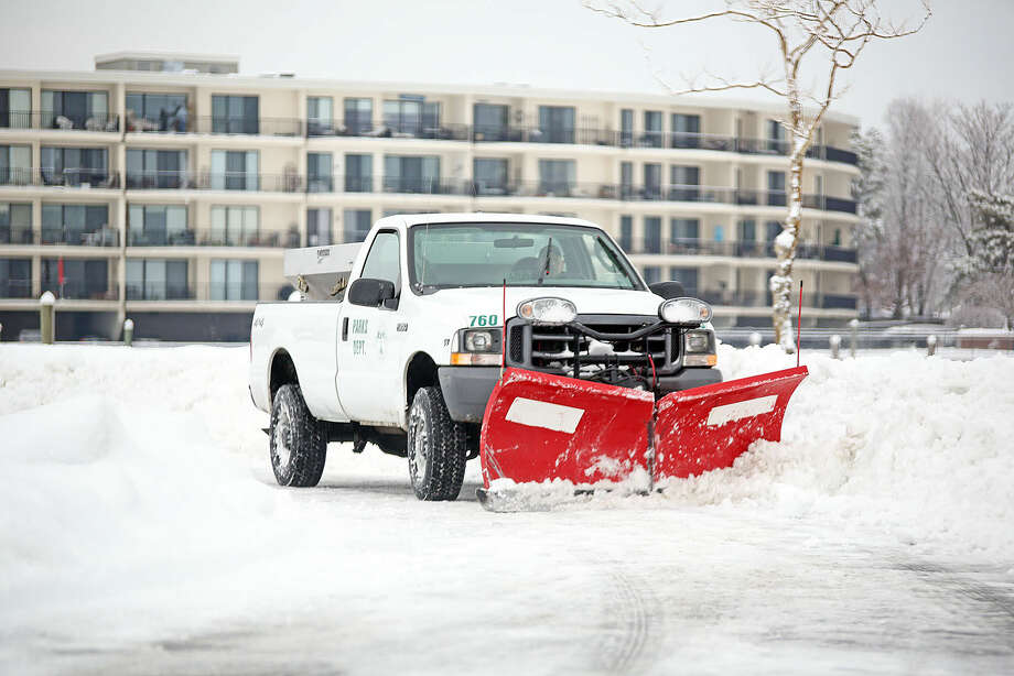 Norwalk's Park's Department plows Veteran's Park after the snow storm Sunday morning. Hour Photo / Danielle Calloway