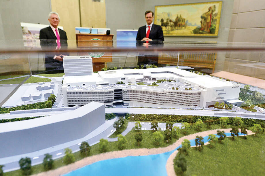 Hour photo / Erik Trautmann General Growth Properties Doug Adams and Norwalk Mayor Harry Rilling unveil a large, three-dimensional model and renderings of The SoNo Collection shopping mall in the City Hall rotunda Friday morning to be used as part of Norwalk Zoning Commission review of plan.