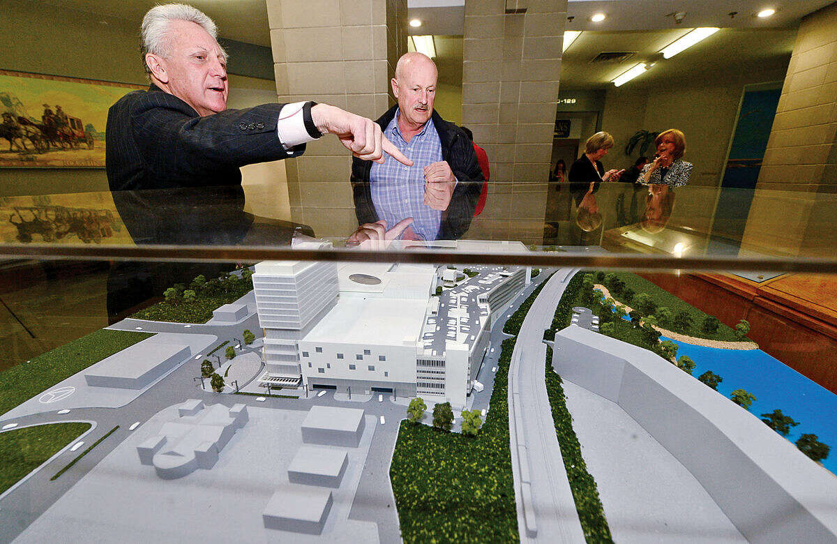 Hour photo / Erik Trautmann Norwalk Mayor Harry Rilling and Richie Ball look over a large, three-dimensional model of The SoNo Collection shopping mall in the City Hall rotunda Friday morning to be used as part of Norwalk Zoning Commission review of plan.