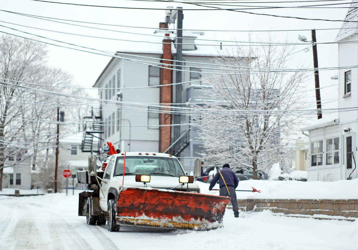A driveway is shoveled on New Street in Norwalk after the snow storm Sunday morning. Hour Photo / Danielle Calloway