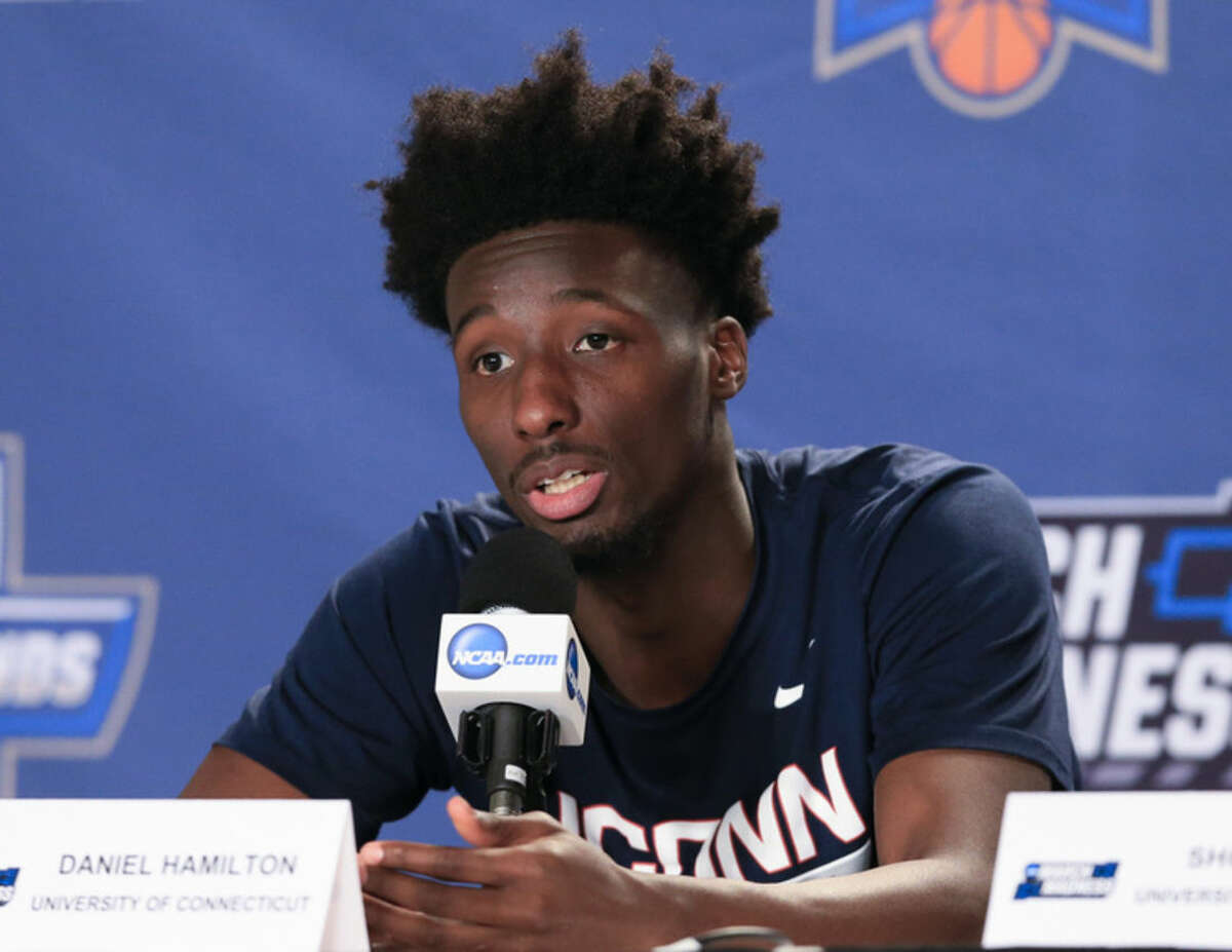 Connecticut's Daniel Hamilton speaks during a news conference ahead of a second-round men's college basketball game in the NCAA Tournament in Des Moines, Iowa, Friday, March 18, 2016. Connecticut plays Kansas on Saturday. (AP Photo/Nati Harnik)