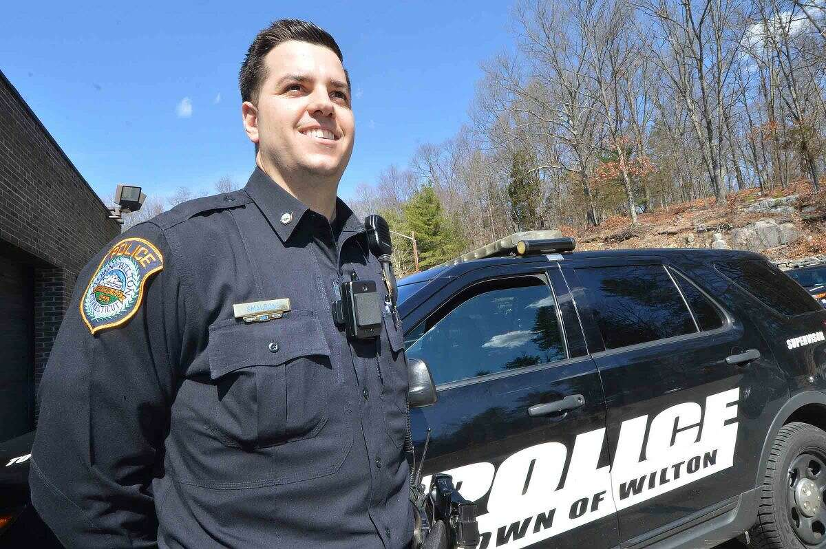 Wilton Police Officer Robert Smaldone with one of the department's new body cameras