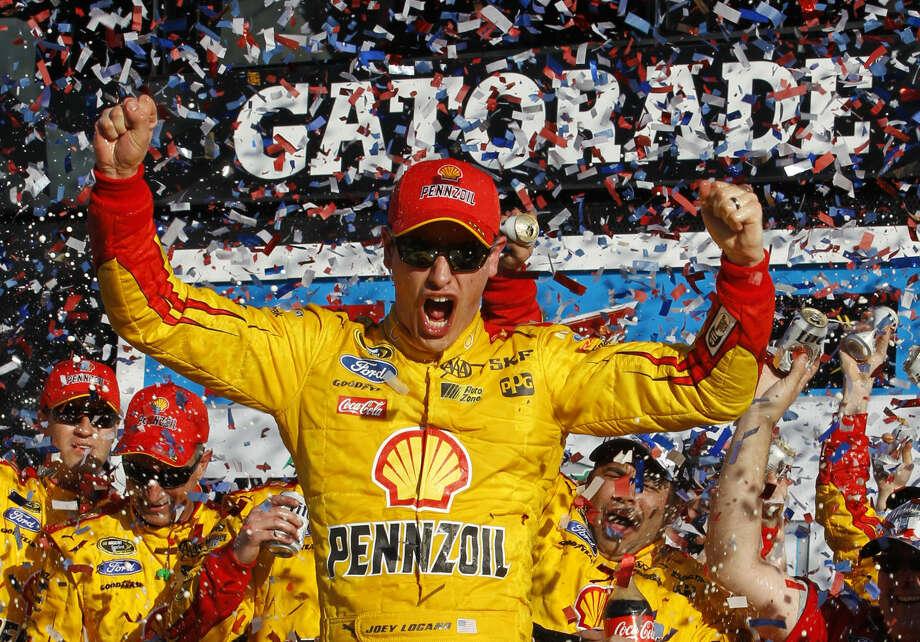 Joey Logano celebrates in Victory Lane after winning the Daytona 500 NASCAR Sprint Cup series auto race at Daytona International Speedway in Daytona Beach, Fla., Sunday, Feb. 22, 2015. (AP Photo/Terry Renna)
