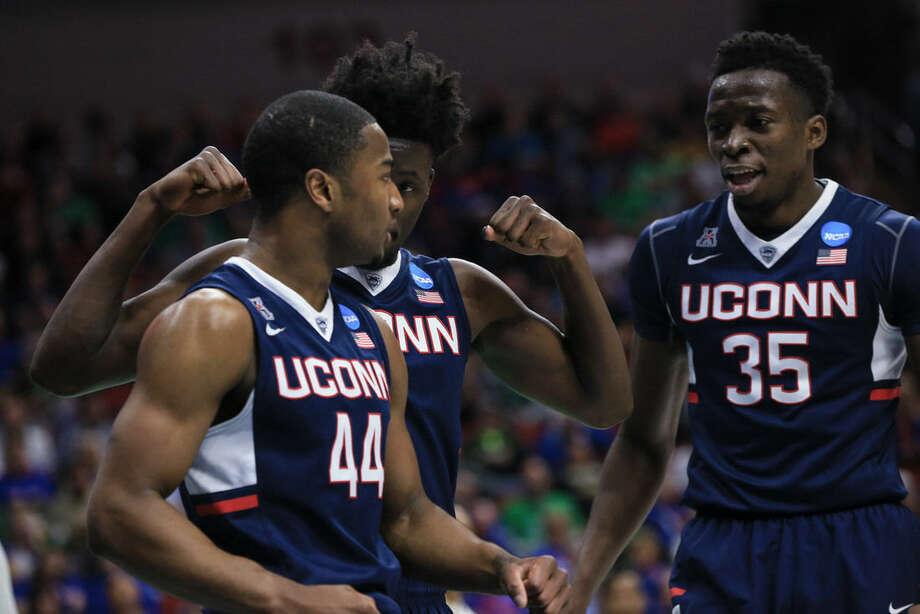 Connecticut's Rodney Purvis (44), Amida Brimah (35) and Daniel Hamilton, center, celebrate after a foul called against Colorado, during a first-round men's college basketball game in the NCAA Tournament in Des Moines, Iowa, Thursday, March 17, 2016. Connecticut won 74-67.(AP Photo/Nati Harnik)