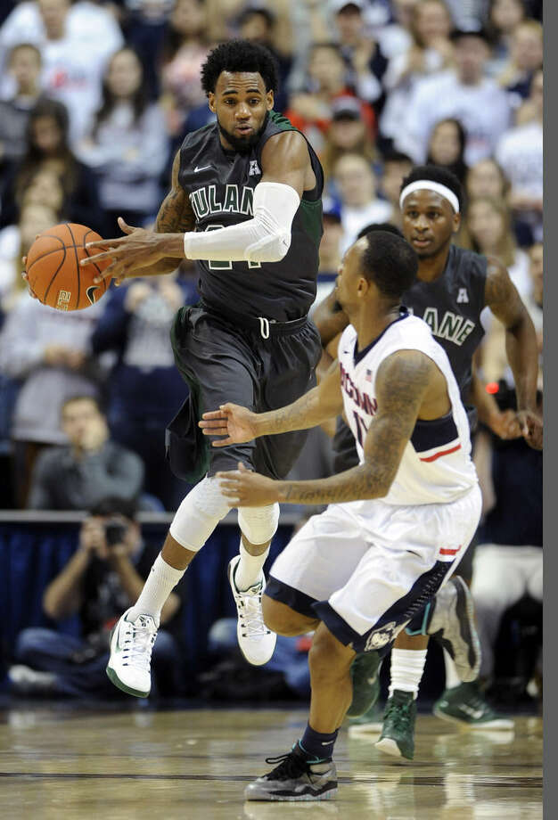 Connecticut's Ryan Boatright, right, guards Tulane's Jay Hook, left, during the first half of an NCAA college basketball game, Sunday, Feb. 22, 2015, in Storrs, Conn. (AP Photo/Fred Beckham)
